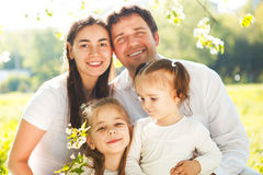 Happy young family with two children. At the spring picnic Stock Photography