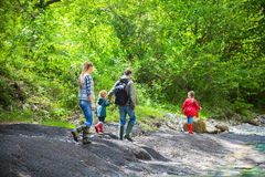 Happy young family with two little daughters near the mountain r Royalty Free Stock Image