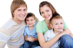 Happy young family with two little sons. Happy young laughing family with two little sons - white background Royalty Free Stock Photo