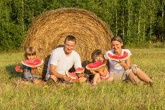 Happy young family on vacation Stock Images