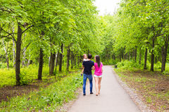 Happy young family walking in green nature. royalty free stock images