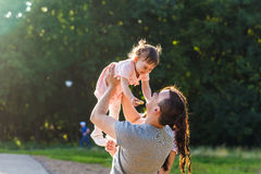 Happy Young Family Walking In The Park Royalty Free Stock Images