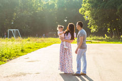 Happy Young Family Walking In The Park Stock Photography