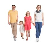 Happy young family walking together Stock Images