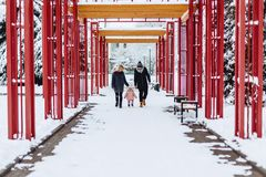 happy young family walks with baby on winter street, mom, dad, c stock photos