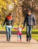 Happy Young Family Walks In The Park Royalty Free Stock Image