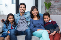 Happy young family watching tv. In living room Royalty Free Stock Images