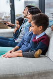 Happy young family watching tv Royalty Free Stock Photography