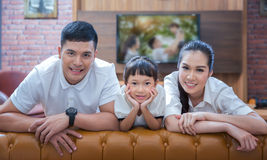 Happy young family wathching flat tv Royalty Free Stock Images