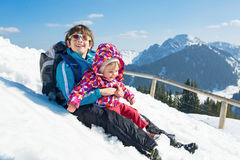 Happy young family in winter vacation royalty free stock photo
