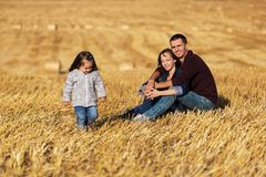 Free Happy Young Family With 2 Year Old Girl In Harvested Field Royalty Free Stock Photo - 102615995