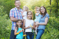 Happy Young Family With Four Children Outdoors Royalty Free Stock Photos
