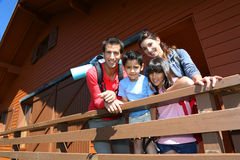 Happy young family in a wooden cabin Royalty Free Stock Photography