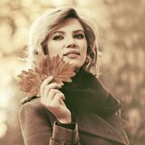 Happy young fashion blond woman walking outdoor Royalty Free Stock Photos