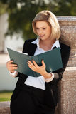 Happy young fashion business woman with a folder Royalty Free Stock Photo