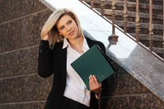 Happy young fashion business woman with a folder Stock Images