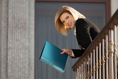 Happy young fashion business woman with a folder Royalty Free Stock Photos
