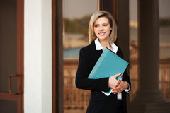 Happy young fashion business woman with a folder Royalty Free Stock Image