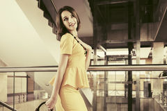 Happy young fashion business woman with handbag in office interior Royalty Free Stock Photos