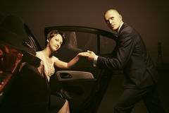 Happy young fashion couple in a car royalty free stock image