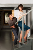 Happy young fashion couple flirting in office Royalty Free Stock Image