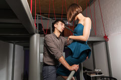 Happy young fashion couple flirting in office Royalty Free Stock Photos