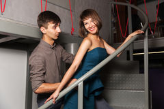 Happy young fashion couple flirting in office Stock Photos
