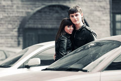 Happy young fashion couple in love on the city street Royalty Free Stock Image