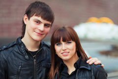 Happy young fashion couple in love on city street Stock Photography