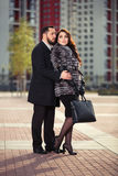 Happy young fashion couple in love on city street Royalty Free Stock Photo