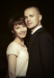 Happy young fashion couple in love in night city street Royalty Free Stock Images