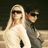 Happy young fashion couple in sunglasses royalty free stock image