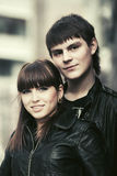Happy young fashion couple walking in city street Royalty Free Stock Image