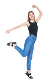 Happy young fashion girl in jeans jumping isolated Royalty Free Stock Image