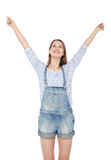 Happy young fashion girl in jeans overalls with hands up isolate Stock Photos