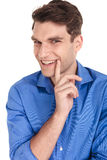 Happy young fashion man smiling at Stock Image