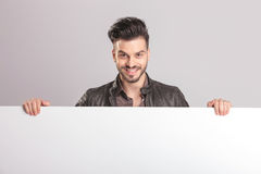 Happy young fashion man smiling to the camera Royalty Free Stock Image