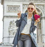 Happy young fashion-monger in Paris, France showing red heart Royalty Free Stock Images