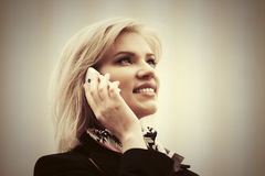 Happy young fashion woman calling on cell phone Royalty Free Stock Photography
