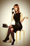 Happy young fashion woman calling on retro phone Royalty Free Stock Image