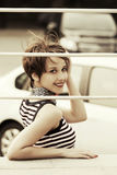 Happy young fashion woman in city street Royalty Free Stock Image
