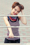 Happy young fashion woman on city street Stock Images