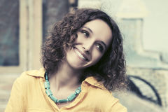 Happy young fashion woman with curly hairs Royalty Free Stock Images