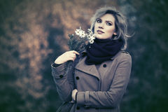 Happy young fashion woman with a flowers walking outdoor Royalty Free Stock Photo