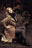 Happy young fashion woman with handbag in autumn park stock photos