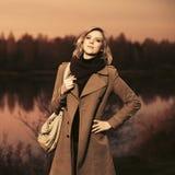 Happy young fashion woman with handbag walking outdoor stock photo