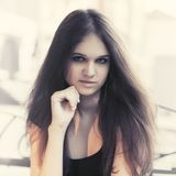 Happy young fashion woman with long straight hairs. In city street royalty free stock photo