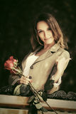 Happy young fashion woman with red roses outdoor Stock Photos