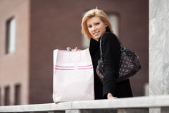 Happy young fashion woman with shopping bags Stock Images