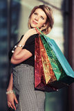 Happy young fashion woman with shopping bags in the mall Royalty Free Stock Images